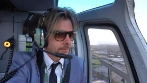 Joel Mielle in helicopter