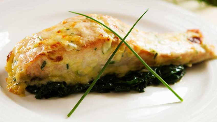 Salmon with a Chive and Mornay Cheese Sauce on Spinach