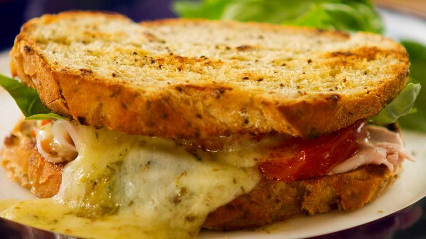Toasted Cheese and Ham Sandwich, Italian style with tomato and basil