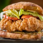 """There are a lot of """"Best fried chicken recipes out there"""", many try to imitate the famous KFC secret recipe. This Italian twisted recipe is my secret and it's so, so delish, and I'm sharing it with you! You simply cannot beat the freshness of homemade fried chicken. This is quite simple to make and despite its simplicity in ingredients. It's spicy, crispy and juicy. I'll be bold enough to claim that it's the best recipe you will ever find. With the smokiness of the paprika, the spicy popcorn like crunchy coating and the brined moist meat, you will be amazed at the outcome using a standard fryer. I've made this using boneless, skinless chicken thighs but you can certainly make it with chicken breast, ideally skin on. The ciabatta bread is toasted in olive oil, coated with garlic mayonnaise, that alone is incredible! Serve this fried chicken with a salad, a few fries on the side and a nice glass of wine! No coke! Make it quick before this becomes the next secret fried chicken recipe!"""